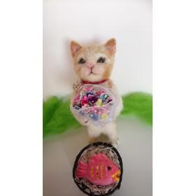 花束を持った猫