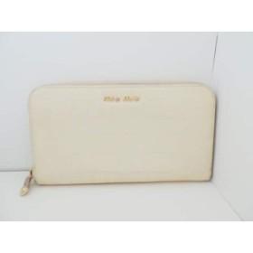 0f52d0095fe9 ミュウミュウ miumiu 長財布 レディース - アイボリー ラウンドファスナー/型押し加工 エナメル(