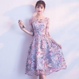 ロマンティックなお花の刺繍入りオーガンジーミモレ丈ドレス