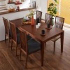 幅4段階に変えられるウォルナット材の伸長式ダイニングテーブル