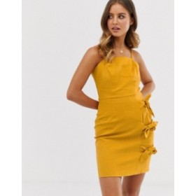エイソス レディース ワンピース トップス ASOS DESIGN cami mini sundress with bow tied skirt Mustard