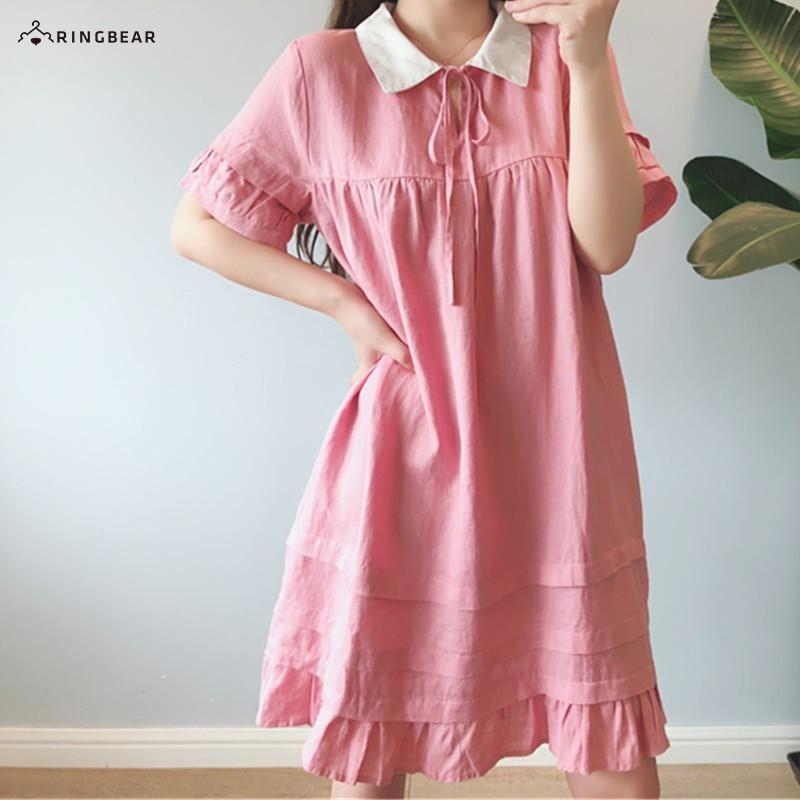 眼圈熊 中大尺碼 甜美日系學院風綁帶娃娃領荷葉下擺素面A字連身裙(粉XL-4L)-D529