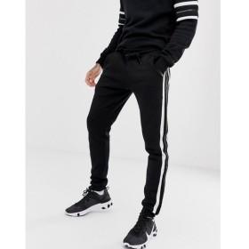 グッドフォーナッシング Good For Nothing メンズ ジョガーパンツ ボトムス・パンツ skinny joggers in black with logo side stripe Black