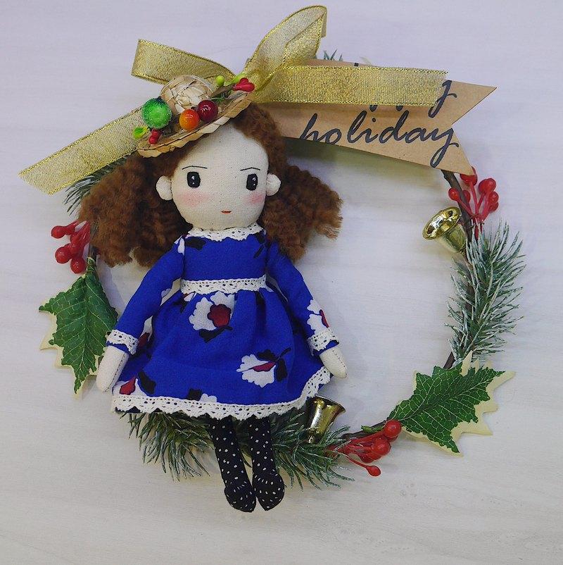 在捲髮的手工製造玩偶