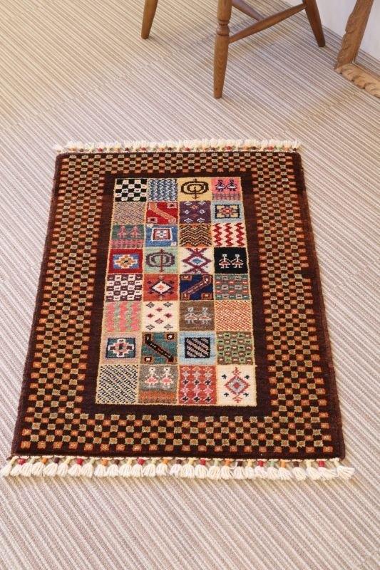 深棕色手工編織地毯入口墊羊毛和植物染料91 x 67厘米