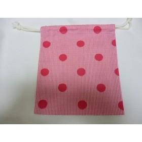 ピンクの水玉柄巾着袋