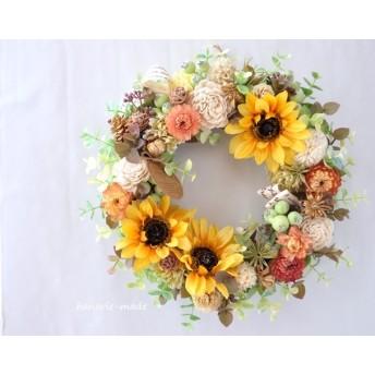 ひまわり と ムギワラギク:wreath