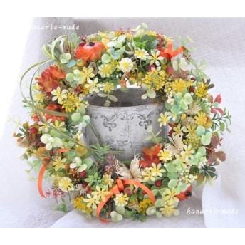 黄色い小花とオレンジリボン:wreath