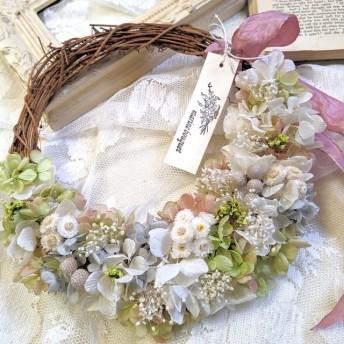小花のハーフムーンリース