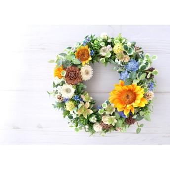 向日葵と青い小花のリース:木の実 オレンジ ブルー 夏