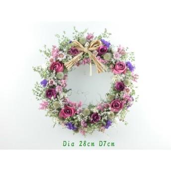 大きなモスリース にバラとピンク系の小花達