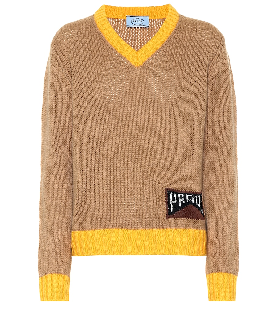 This camel-toned sweater from Prada is made from a soft cashmere blend with a V-neck and a classic,