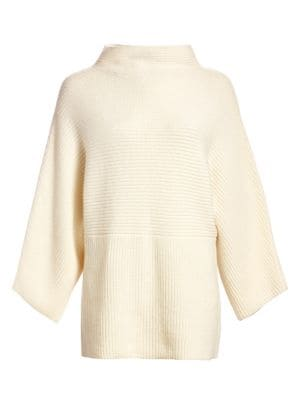 This cozy tunic sweater is crafted from lux cashmere that feels wonderfully soft against the skin. K