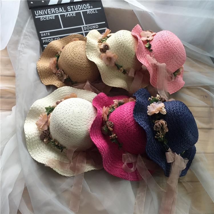 韓版大沿防曬遮陽帽子女夏天沙灘花朵蝴蝶結波浪邊草帽親子兒童帽1入