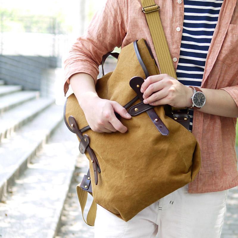 旅行冒險‧日本設計師款個性帆布後背包 (共兩色) 日本簡約皮革滾邊防潑水後背包 - 卡其色