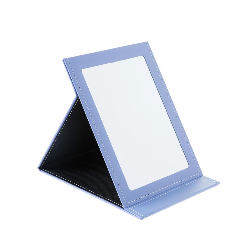 基本信息 品名:台式折疊化妝鏡 K8994尺寸:約23*16.5cm材質:PU+鏡子包裝:OPP重量:260g款式:如顏色列表所示,可選概要:防水耐臟PU材質,台式可立,便於折疊,圖案清新可愛,照出更