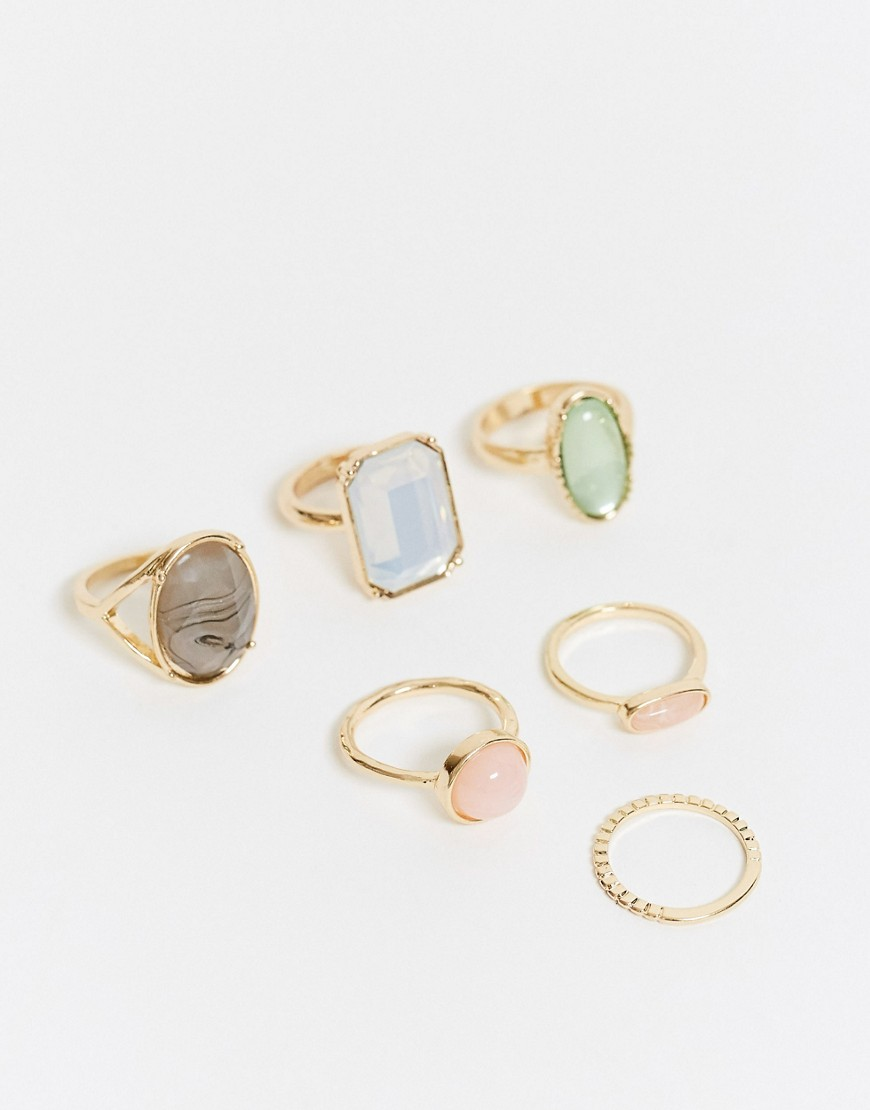 ASOS DESIGN pack of 6 rings with multi coloured stones in gold tone