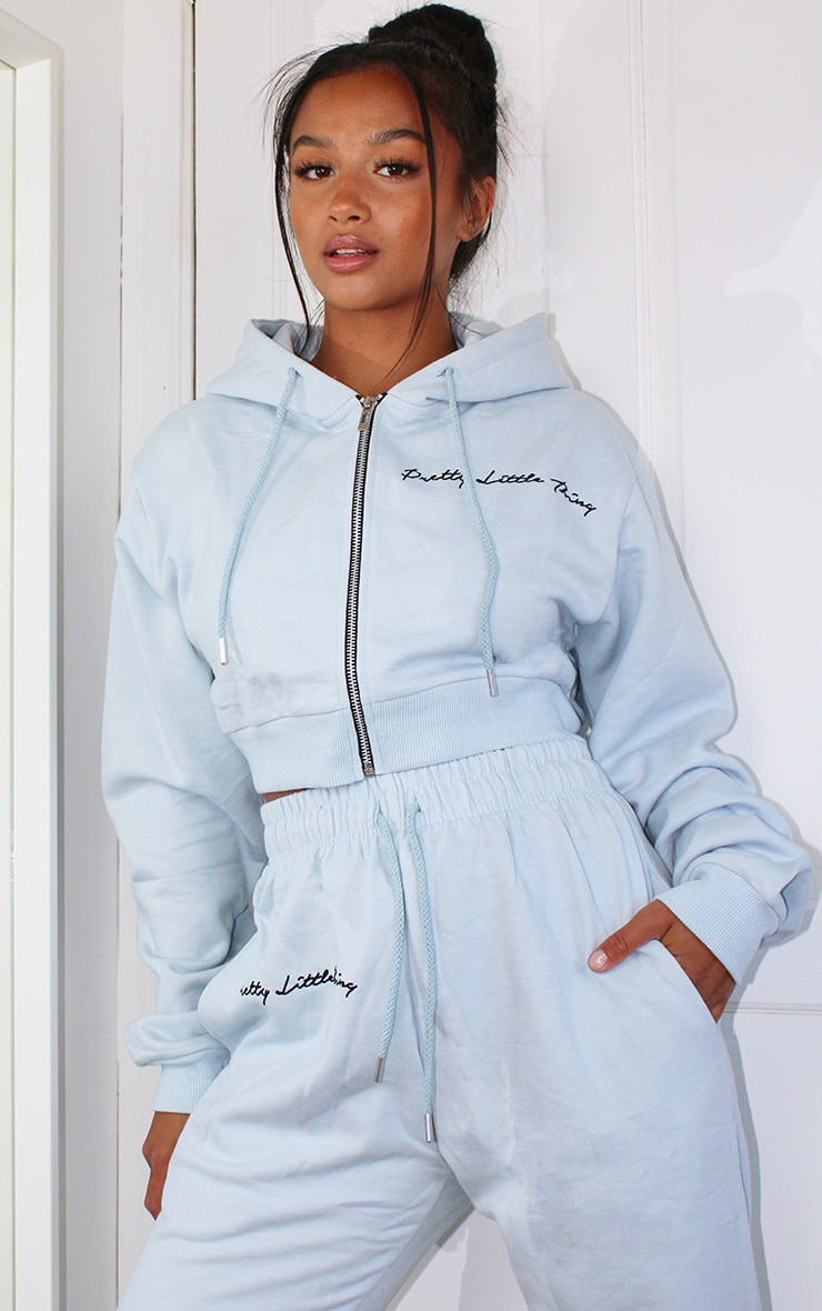 PRETTYLITTLETHING Petite Baby Blue Cropped Embroidered Zip Hoodie