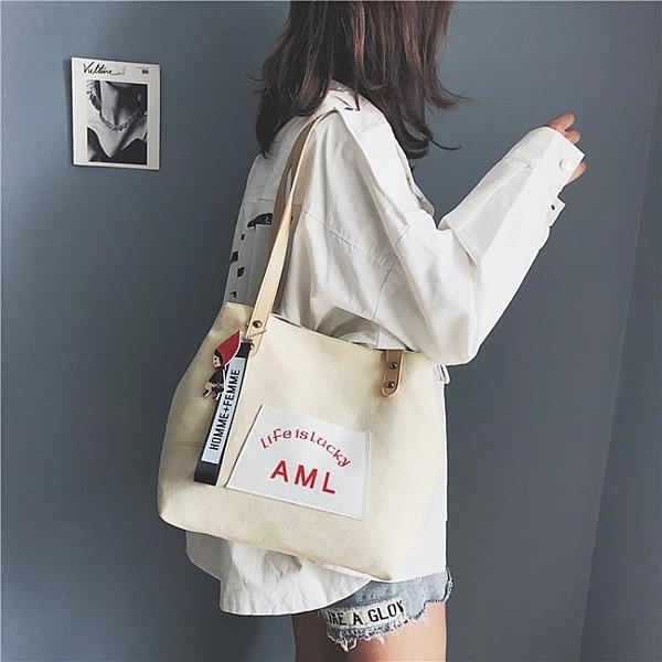 手提包 ins超火帆布包包女2021新款潮韓版時尚百搭單肩斜跨袋手提托特包
