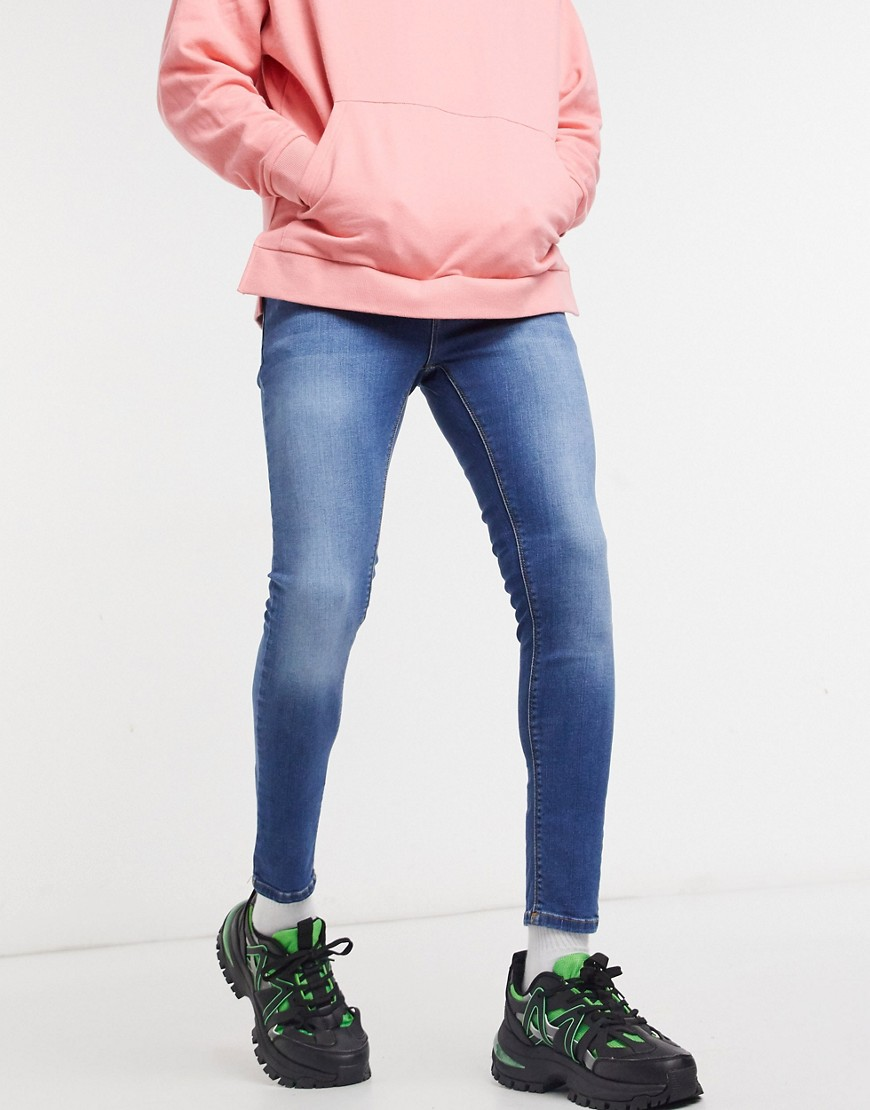 ASOS DESIGN spray on jeans with powerstretch in mid wash blue