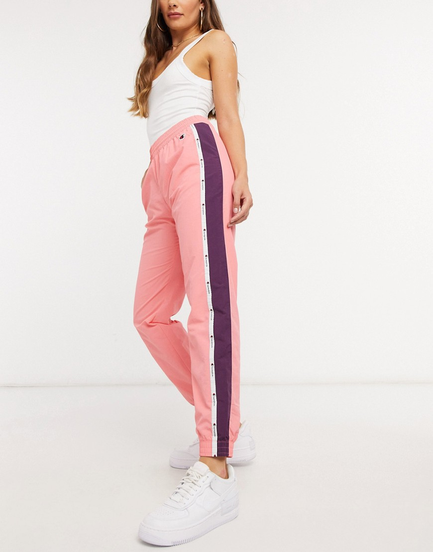Champion logo track pants in pink