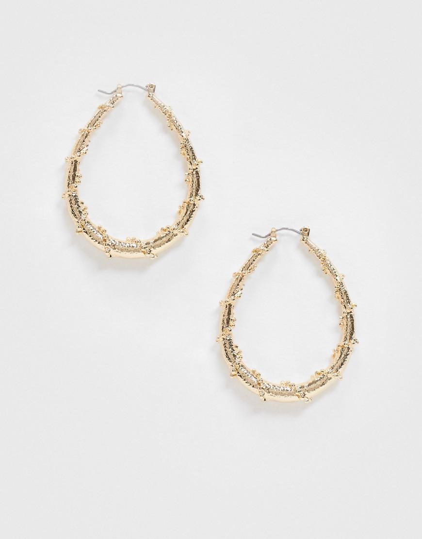 Topshop oval hoop earring in gold twist