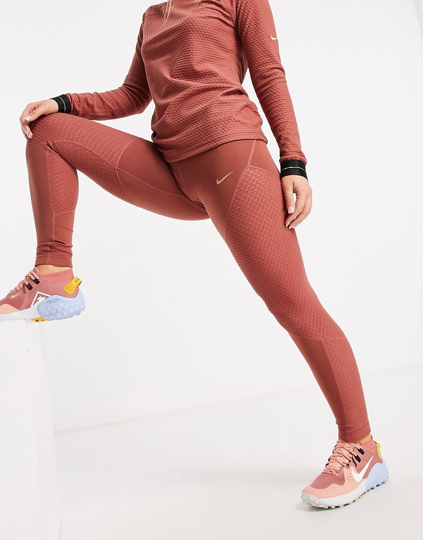 Nike Training Icon Clash warm leggings in claystone red