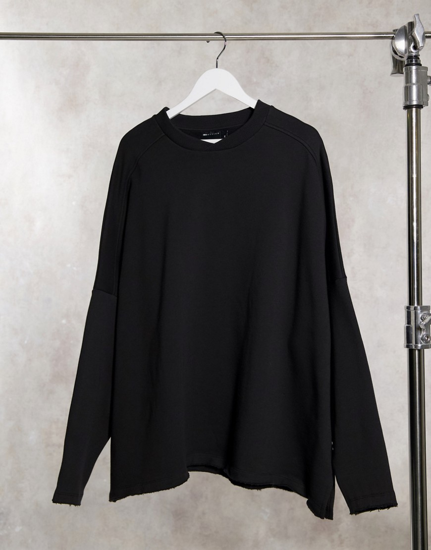 ASOS DESIGN oversized turtle neck sweatshirt with raw hem in washed black