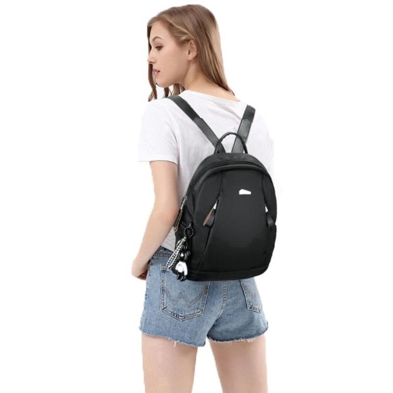黑色防盜包後背包旅行手提袋時尚白色耳機孔大包