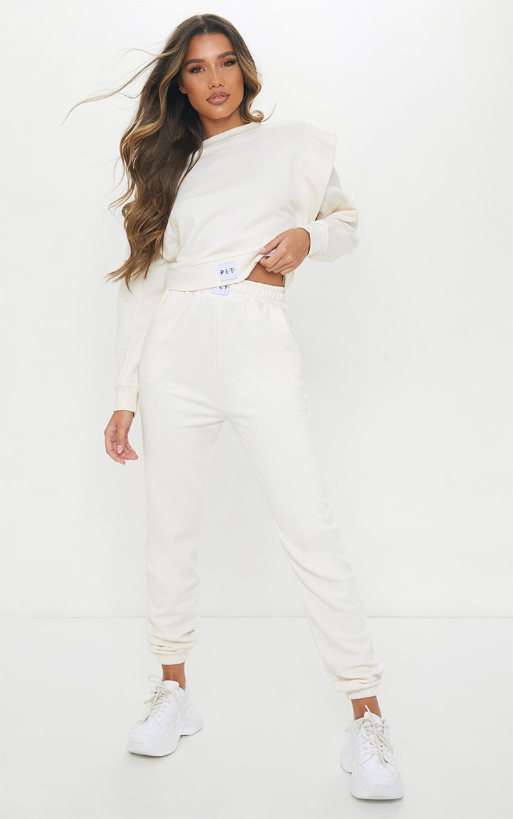 PRETTYLITTLETHING Cream Badge Detail Cuffed Track Pants