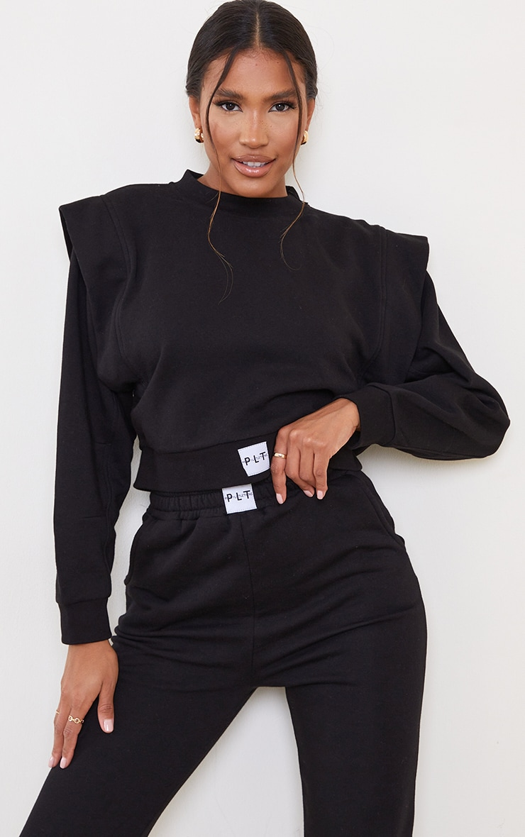 PRETTYLITTLETHING Black Badge Seam Sleeve Detail Cropped Sweater