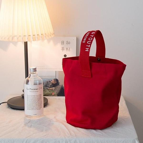 水桶包日韓chic簡約帆布休閒百搭小手拎挽包隨身便攜飯盒袋手機包 新年優惠