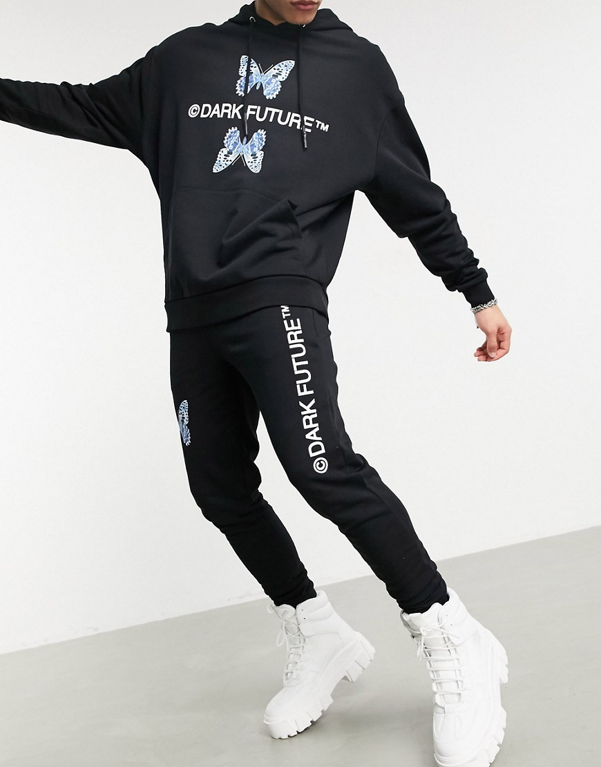 ASOS Dark Future co-ord skinny joggers in black with butterfly logo