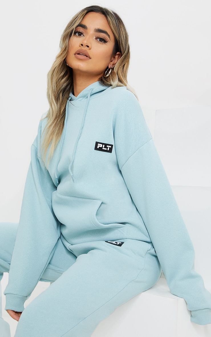 PRETTYLITTLETHING Petite Sage Blue Badge Detail Oversized Hoodie