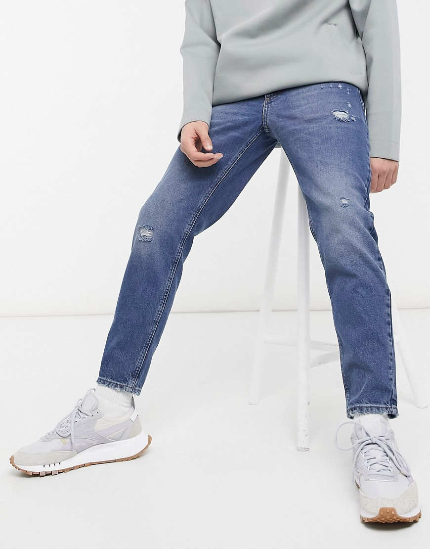 ASOS DESIGN classic rigid jeans in vintage mid wash with abrasions-Blue