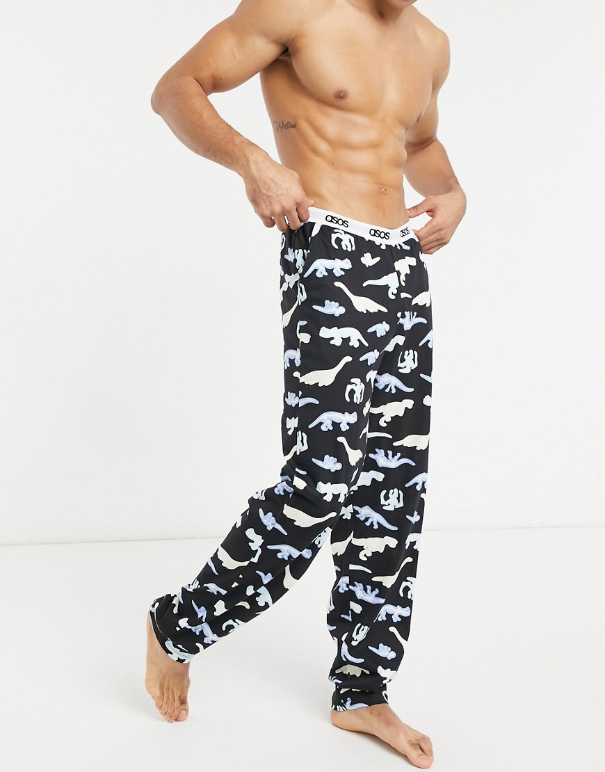 ASOS DESIGN lounge bottoms in black with bright dino print