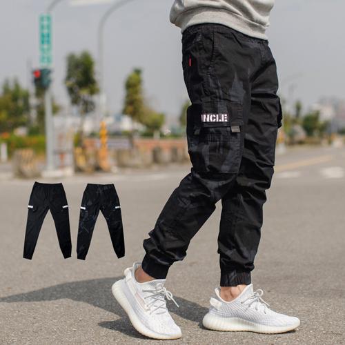 【NB0694J】黑色皮標多口袋抽繩褲頭工作褲縮口褲(UC6616.17)