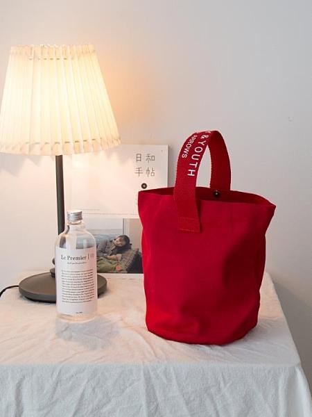 (磁扣)日韓chic簡約帆布水桶包休閑百搭小手拎挽包隨身便攜飯盒袋手機包