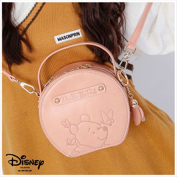 天藍小舖-迪士尼系列甜蜜花園烙印小熊維尼款手提/斜背圓形包-單1款-$990【A17173269】