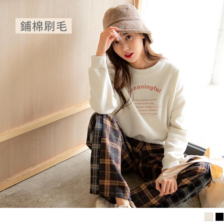 台灣製造。內刷毛英字印花長袖上衣