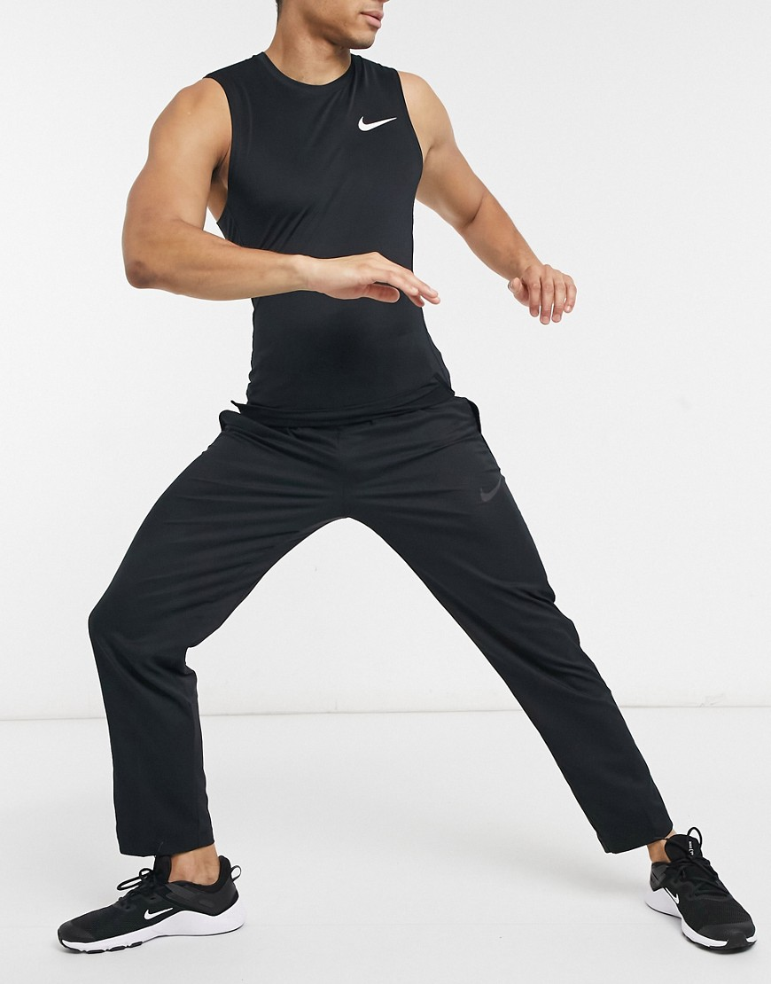 Nike Training Dri-FIT team woven jogger in black-White