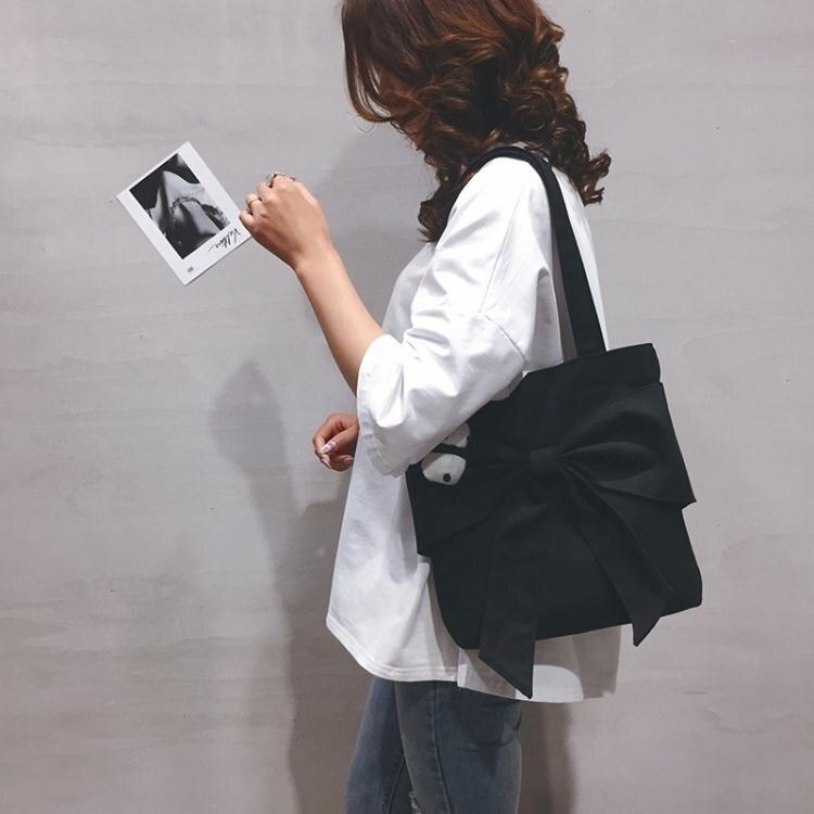 蝴蝶結包包帆布大包包女包新款韓版蝴蝶結手提包慵懶少女休閒購物側背包