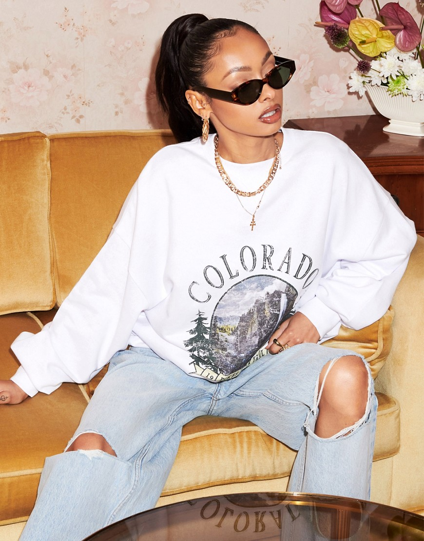 ASOS DESIGN sweatshirt with colorado graphic in white