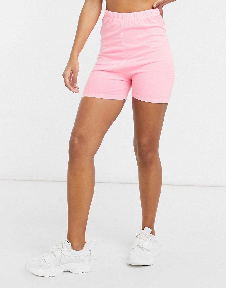 ASOS DESIGN shorter length cotton legging short in washed hot pink