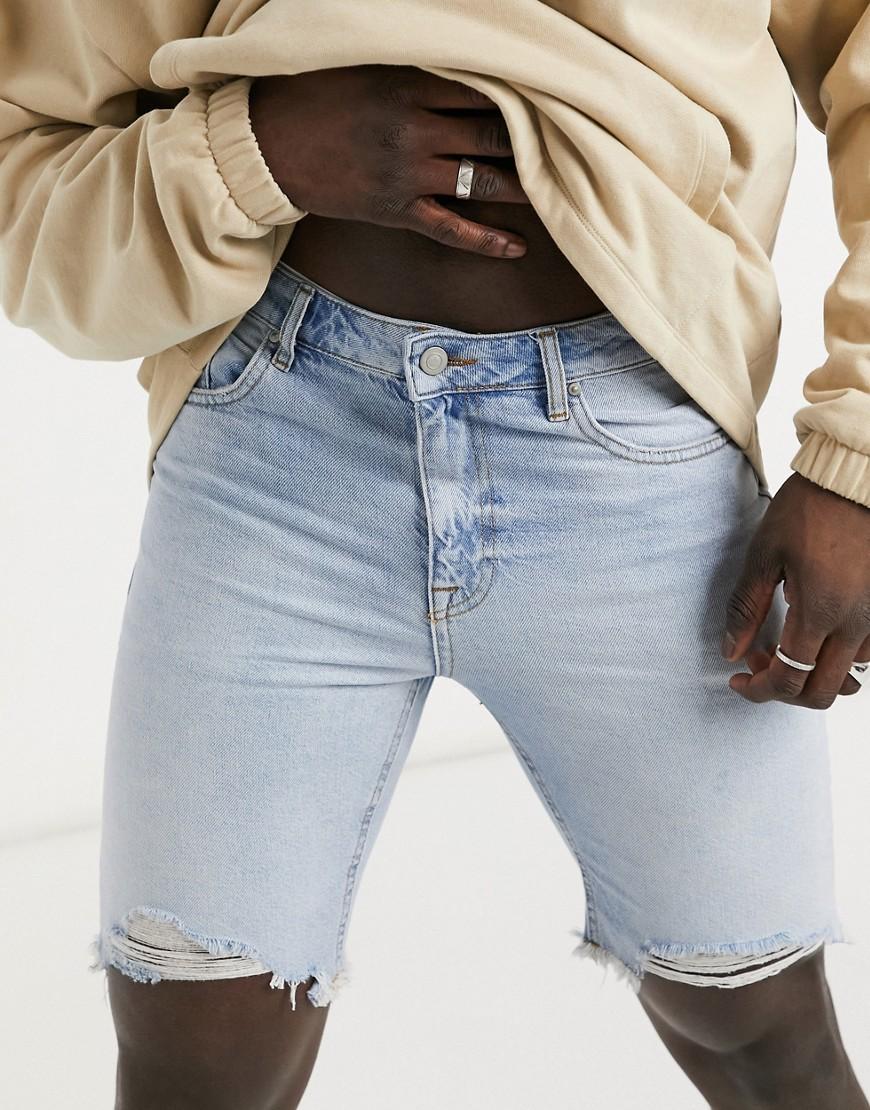 ASOS DESIGN slim denim shorts in light wash blue with raw hem
