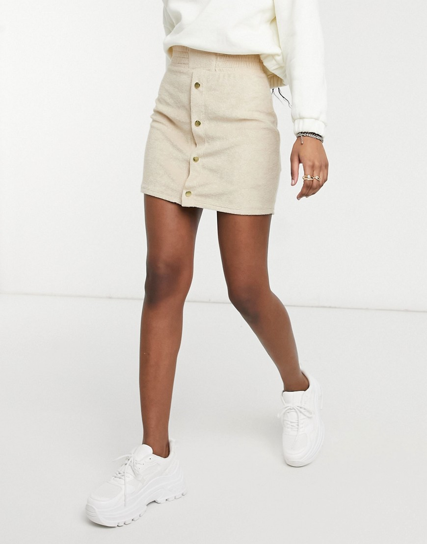 ASOS DESIGN fluffy towelling mini skirt with popper front detail in sand-Brown