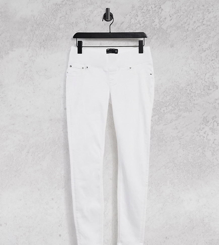 ASOS DESIGN Maternity high rise ridley 'skinny' jeans in optic white with over the bump waistband