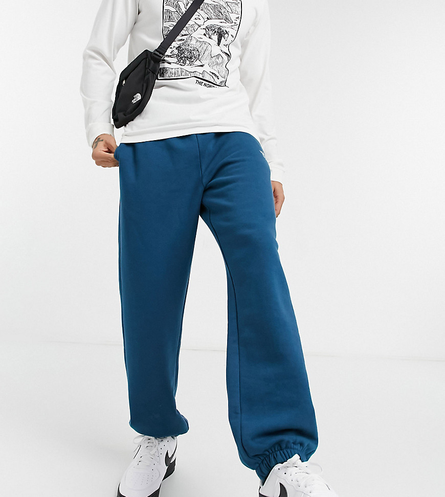 The North Face Oversized Essential joggers in blue Exclusive at ASOS