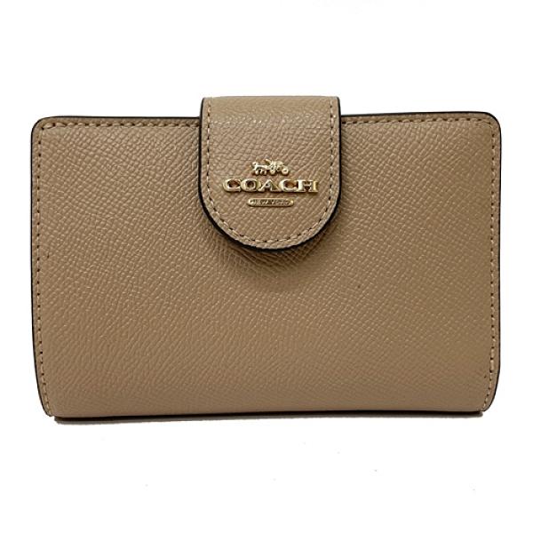 【COACH】新款經典LOGO鈔票零錢袋中夾(膚)