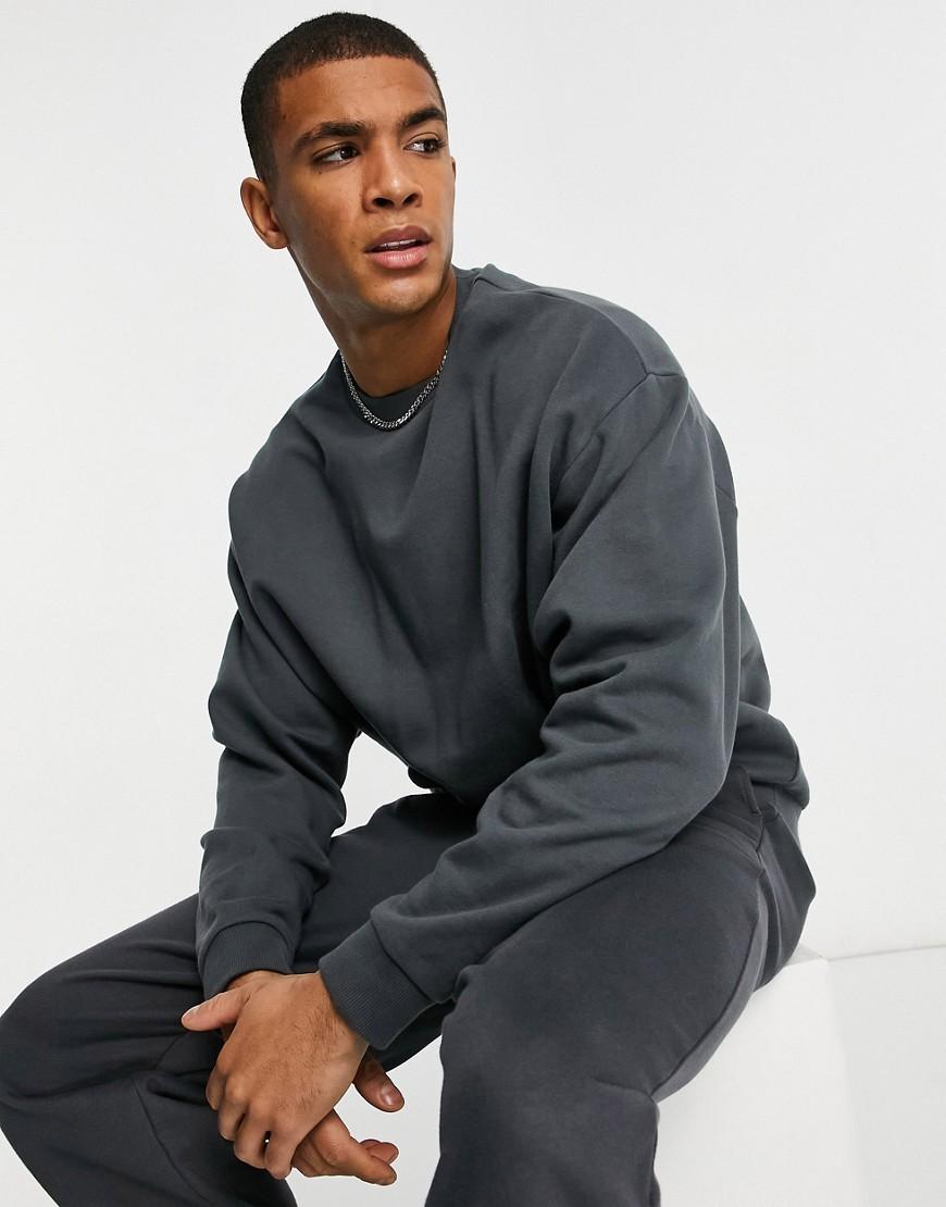 ASOS DESIGN oversized sweatshirt in washed black